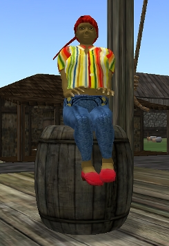 Iyoba sits on a barrel in the Land of Sodoma